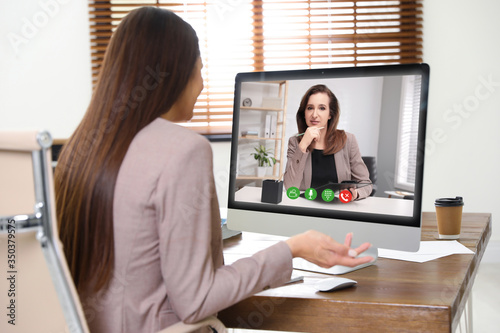 Fotografía Woman using video chat for online job interview in office