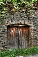 Old Wooden Door Of Stone Building