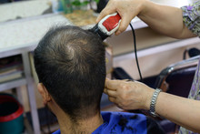 Close-up Of Hairdresser Using ...