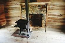 Empty Fireplace In Log Cabin