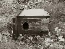 Abandoned Birdhouse On Field