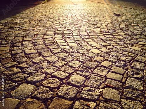 Carta da parati High Angle View Of Sunlight On Paving Stone Footpath
