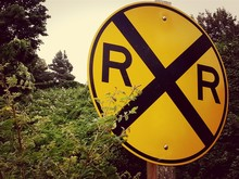 View Of Yellow Railroad Crossing Sign