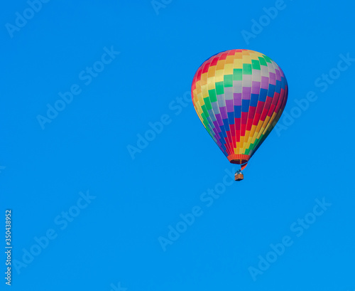 Fotografiet Low Angle View Of Hot Air Balloon Against Clear Blue Sky