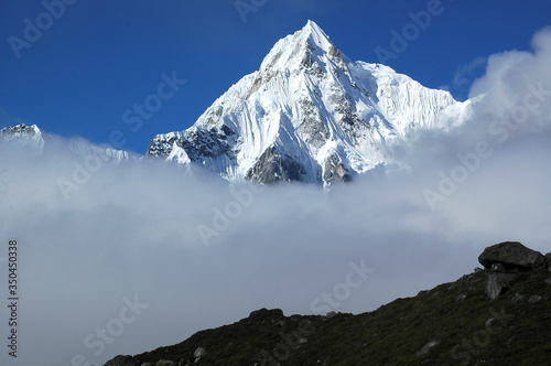 Peak in engulf in clouds in high altitude areas Canvas Print