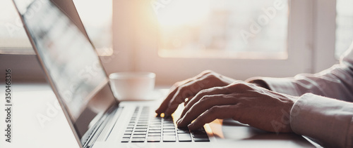 Obraz Man hands typing on computer keyboard closeup, businessman or student using laptop at home, panoramic banner, online learning, internet marketing, working from home, office workplace freelance concept - fototapety do salonu