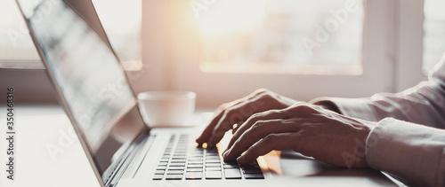 Fotografia, Obraz Man hands typing on computer keyboard closeup, businessman or student using lapt