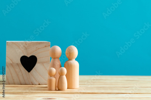 Wooden little figures of people close up. Family concept