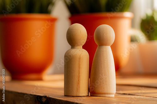 Small wooden figures of family members close up. Family relationship symbol
