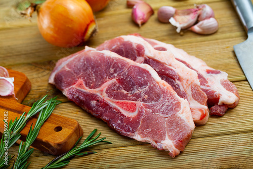 Fototapeta Raw pork's fillet shoulder with rosemary and garlic obraz