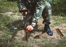 Minesweeper Is Preparing For A Mine Detonator. Soldier Sets Anti-tank Mine. Outdoors