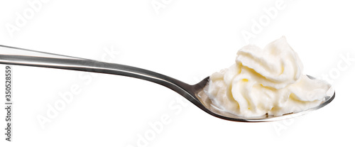 white cream on a spoon isolated on white Canvas-taulu