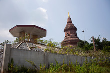 Chedi Or Stupa Or Pagoda Of Wat Phuttha Nimit Or PhuKhao Temple For Thai People And Foreign Travelers Travel Visit And Respect Praying Ancient Ruins Reclining Buddha At Sahatsakhan, Kalasin, Thailand