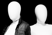 Faceless Mannequins In Shop Window