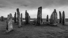 Ancient Neolithic Callanish Stones Are Standing Stones Placed In A Cruciform Pattern With A Central Stone Circle. Neolithic Era, Ritual Focused In Monochrome