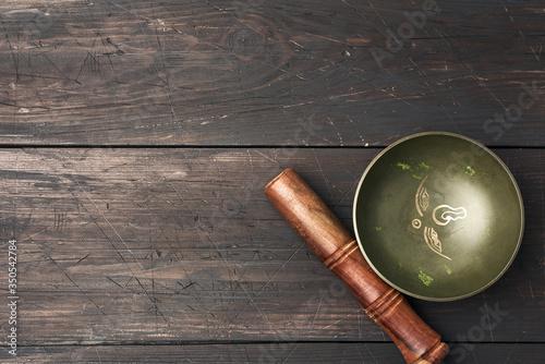 Fototapeta Tibetan singing copper bowl with a wooden clapper obraz