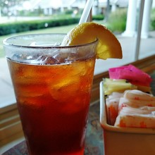 Close-up Of Ice Tea With Lemon Slice On Table By Window