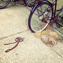 Rusty Chain Of Bicycle On Street
