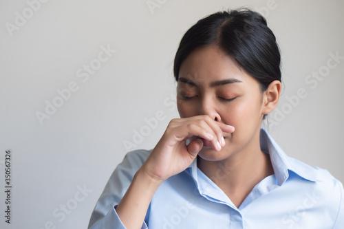Vászonkép sick woman having runny nose due to virus outbreak; concept of preventive health