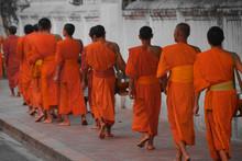 Buddhist Monks Walk Tak Bat In...