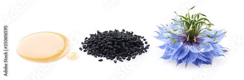 Fototapeta Black cumin oil. Black cumin seeds. Nigella sativa flower. obraz