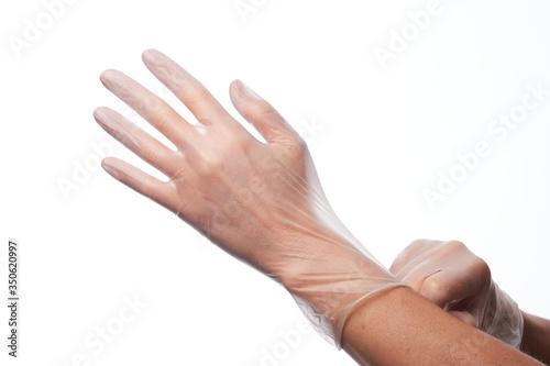 Valokuvatapetti Manos utilizando guantes de latex y de vinilo