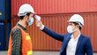 Safety of engineering team or foreman Have a helmet, Body thermometer to healthy while working and mask in factory or container. Prevent accident work or dust and Coronavirus. Concept New Normal