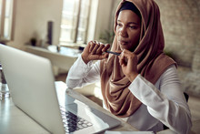 Pensive Muslim Businesswoman W...