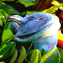 Close-up Of Blue Frog Statue A...
