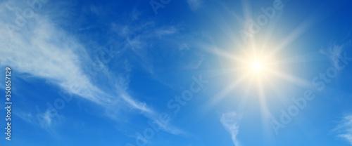 Obraz Blue sky and Bright midday sun illuminates the space. Wide photo . - fototapety do salonu