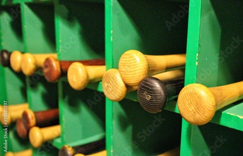Fotografiet Baseball Bats On Shelves