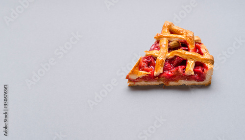 Fototapeta Rhubarb and strawberry pie close-up. One slice of pie obraz