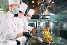Chefs In Protective Masks And ...