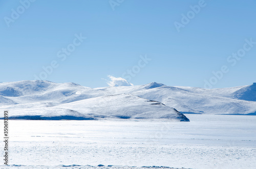 Fototapety, obrazy: Snow covered lake under blue sky