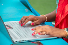 African Woman Using A Laptop C...