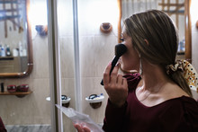 Young Woman Puts On Makeup In ...