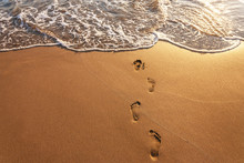 Footsteps On The Beach At Summer.