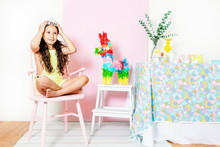 Girl On Pink Chair With Crown At Home Party By Table Pastel Decor