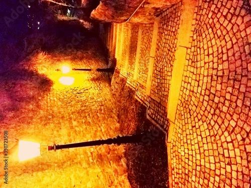 Stampa su Tela Illuminated Street Light By Paving Stone Street