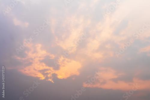 Fototapeta Orange light shining through the overcast clouds. obraz na płótnie