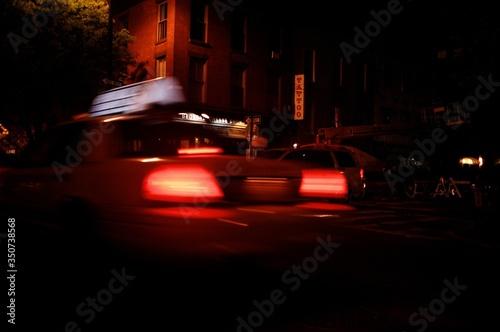 Cars On Illuminated Street At Night Fototapet