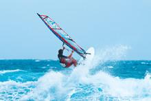 Summer Sports: Windsurfer Ridi...