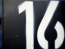 Close-up Of Number 16 On Metal
