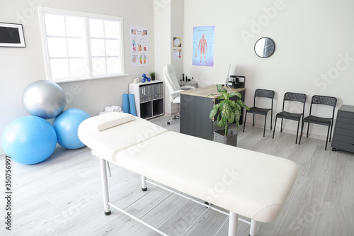 Fototapeta Office of massage therapist in modern medical center obraz