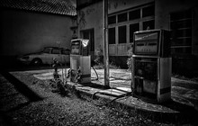 Vintage Vehicle At Abandoned Gas Station