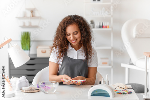 Portrait of manicure master in beauty salon