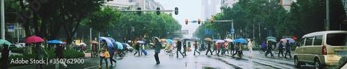 Panoramic Shot Of People On City Street During Rainy Season