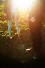 Tilt Shift Shot Of Man And Woman Standing On Grass