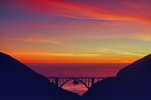 Dramatic Sunset Over Bixby Bridge From Highway One On The Monterey Peninsula.