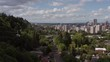 Wide Booming Down Shot of the Portland Aerial Tram with downtown Portland Oregon in the background.